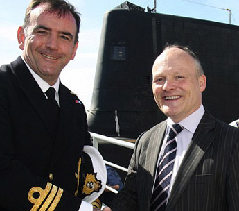 Royston Smth pictured with commanding officer Cdr Iain Breckenridge